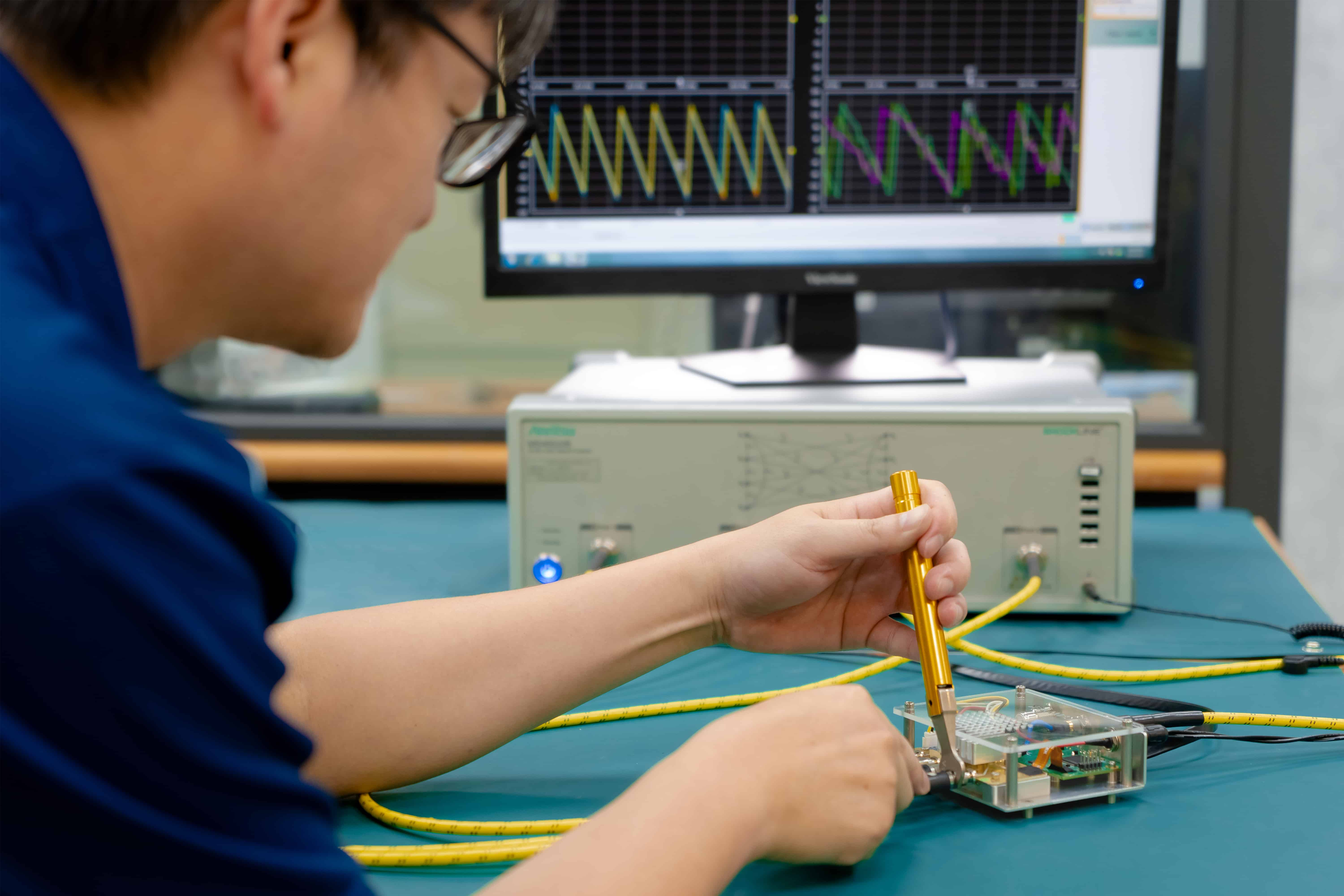 Student in a lab with the Board, running tests.