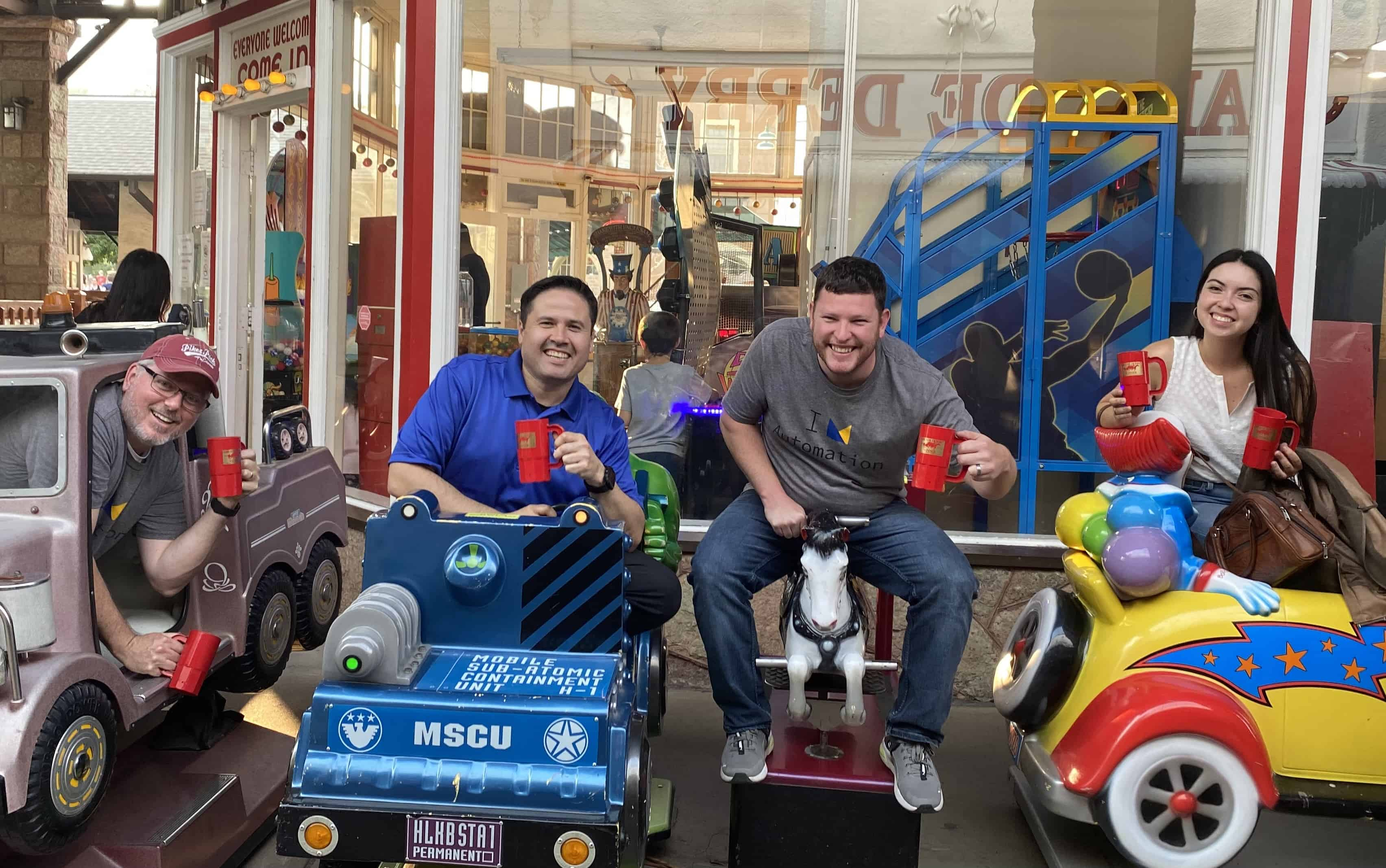 Solubit team members at the penny arcade.